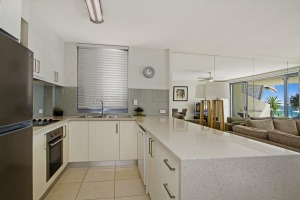 A kitchen at Fairshore Beachfront Apartments at Noosa.
