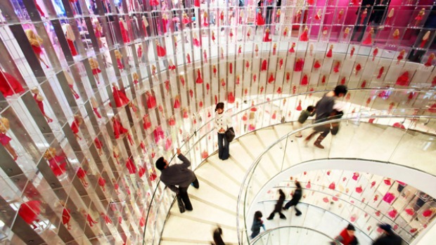Tickled pink ... Shanghai's Barbie store, the biggest in the world. A three-storey spiral staircase featuring 875 dolls ...