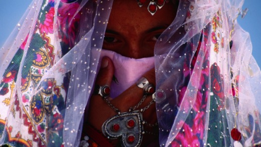 A bride wears  traditional Turkmen headwear and jewellery,