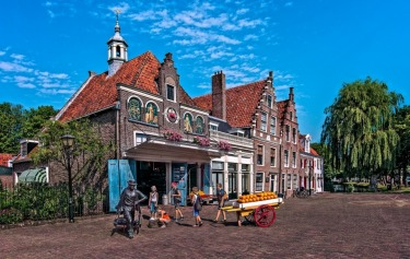 This photograph of an Edam cheese factory, was taken in the Village of Edam in Holland in July 2015. The local children ...