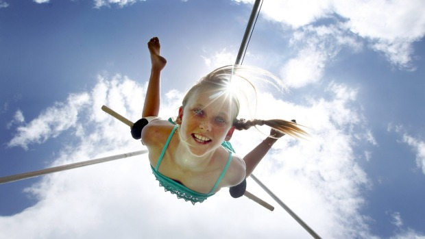 Swinging from a trapeze.