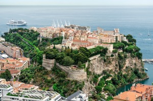 Monaco - it's tiny and shares its border with only one other country.