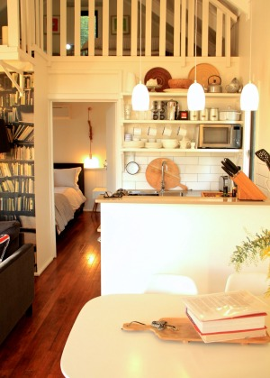 The kitchen is well decked out with Smeg oven, microwave, Nespresso machine and quality cookware.