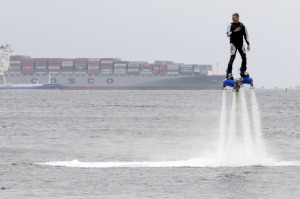 A participant rides a flyboard during a performance, part of a local cultural and sports festival, in the far eastern ...