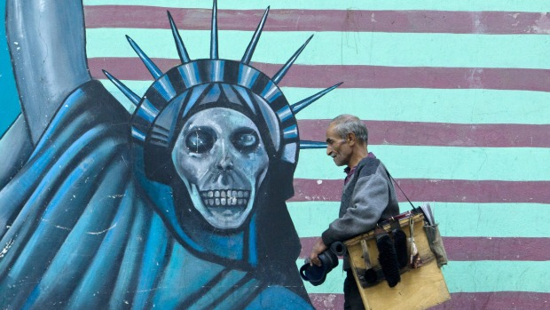A satirical drawing of  the Statue of Liberty on the wall of the former US embassy in Tehran.