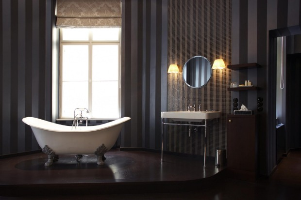 """The Felix suite's bath is the centerpiece of the room, designed for """"one's own body put on show, a ritual of seduction ..."""