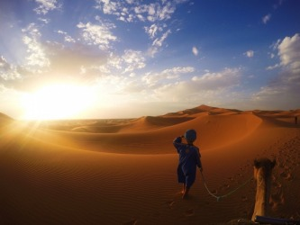 The last night of Ramadan. Taken from my camel on the 17th of July, 2015 in the Sahara Desert, Morocco. The photo captures a Berber man who walked the camel across the dunes for an hour in 47 degree heat before breaking his 14 hour fast for the last time at our campsite. A truly amazing moment as the sun set on the last day of Ramadan 2015.