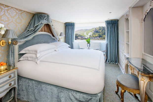Sink into a Savoir bed in a stateroom on Uniworld's SS Maria Therese river cruise ship.