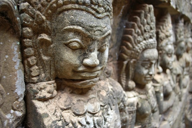 ANGKOR THOM, CAMBODIA: Angkor Wat is the one that makes the postcards, but the giant Angkor Thom complex was the real ...