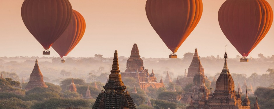 Hot air balloon over plain of Bagan in misty morning, Myanmar.