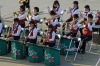 A high-school band gives the ship a send-off from Kagoshima port.