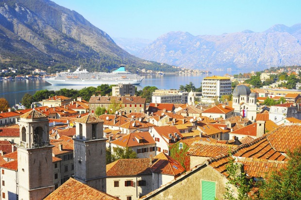 Cruise ship in the bay of Old Town of Kotor, Montenegro.
