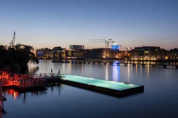"The floating pool: Plenty of European cities celebrate the arrival of summer by opening ""beaches"" on the banks of their ..."