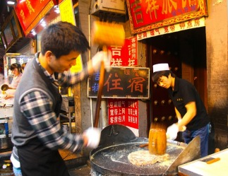Amazing experience walking through the bustling crowds in Muslim St, Xian, China. These candy makers were pounding ...
