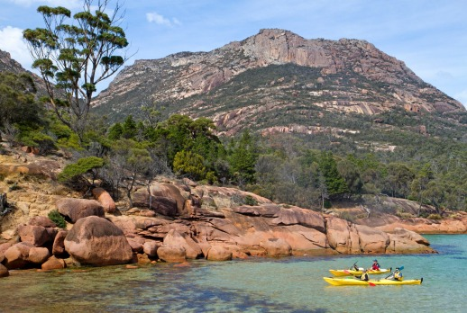 Freycinet Peninsula, Tasmania: Kayaking along the foot of the Hazards on Freycinet Peninsula.