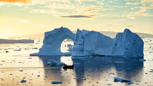 Icebergs in midnight sun, in Disko Bay, Greenland, on the Ilulissat Icefjord.