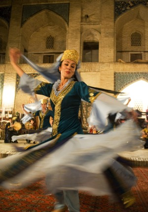 A tradition Uzbek dancer twirls at a folklore show in Bukhara, Uzbekistan.