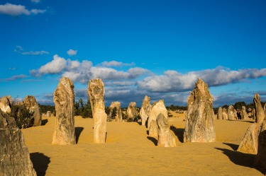 Pinnacles National Park, known as Nambung to the traditional owners, is a mysterious place unexplained by science. Fields of rocks of unknown origin stand vertically out of the sand dunes like fossilised sentinels from a forgotten history.