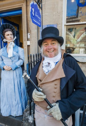 "At the Jane Austen Centre entrance, greeter Martin Salter is known as ""England's most photographed man""."