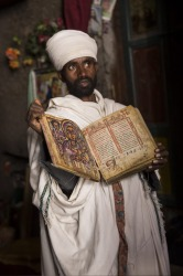 Lalibela, Ethiopia was one of the highlights of my Africa trip. One of the holiest cities in Ethiopia, it consists of 11 UNESCO monolithic churches that were carved from within the earth from living rock. Here, a priest is showing us a century old goat-skin book at the Asheton Maryam Monastery, which sits high above Lalibela on Mount Abuna Yosef at an altitude of nearly 4,000m. The Monastery is impressively carved out of a vertical cliff face.