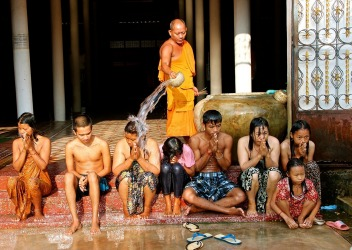 Waterblessing of a family in Cambodia. A serious moment for this family, until they spotted me taking a photo. Then the ...
