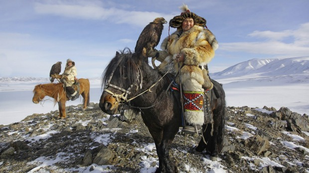 Epic Kazakh Golden Eagle hunters on horseback.