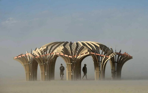 'Burners' stand inside an art sculpture during a dust storm at Burning Man in the Black Rock Desert near Gerlach, ...