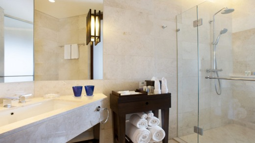 Family adventure suites at the Holiday Inn Resort Bali Benoa have a separate bathroom with rubber duck shower head and ...