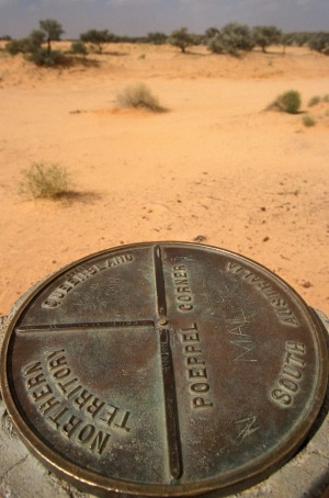A sign at Poeppel Corner in the Simpson Desert, South Australia.