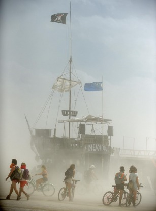'Burners' hangout on the playa during a dust storm at Burning Man in the Black Rock Desert near Gerlach, Nevada.