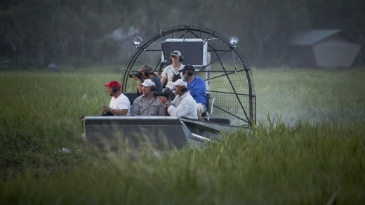 An airboat traverses a floodplain at Bamurru Plains safari camp.