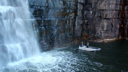 The King George Falls thunder down the 80-metre cliff, dwarfing The Great Escape's tender boat.