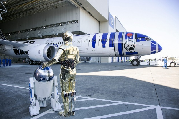 Star Wars characters R2-D2 and C-3PO at unveiling of the R2-D2-themed All Nippon Airways 787 airplane.
