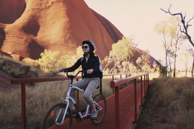 CYCLE AROUND THE ROCK: To walk around the base of Uluru - a loop of about 11 kilometres - is a commitment of hours and ...