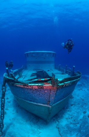 A diver checks out a wreck off the coast of the Cocos Islands.