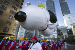A giant Snoopy balloon is marched through Columbus Circle during the Annual Macy's Thanksgiving Day Parade.