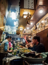 "Omoide Yokocho, or better known as ""Piss Alley"", is a small network of alleyways filled with dozens of small eateries. This photo of one of the eateries embodies everything that is Tokyo - the food, the people and the tight spaces."