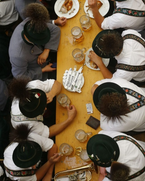 Musicians drink beer in a tent after the traditional costume and riflemen's parade on the second day of the 182ND ...