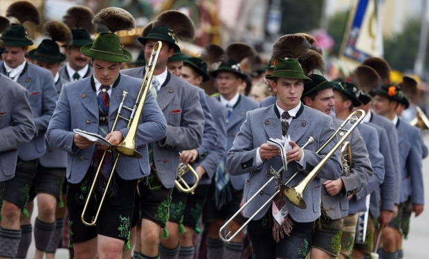 Musicians participate in the traditional costume and riflemen's parade on the second day of the 182nd Oktoberfest beer ...