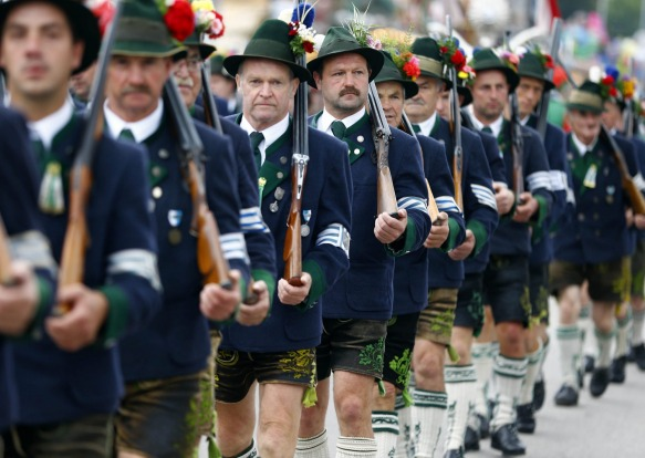 People participate in the traditional costume and riflemen's parade on  the second day of the 182nd Oktoberfest beer ...