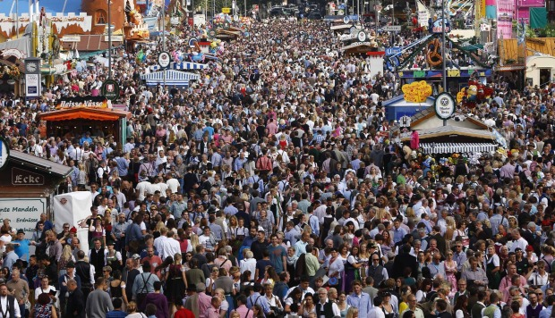 Visitors enjoy the opening day of the 182. Oktoberfest beer festival in Munich, southern Germany.