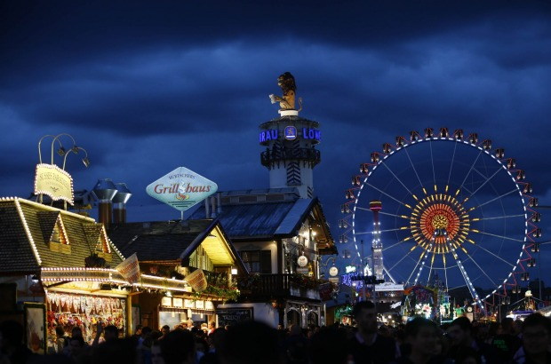 People enjoy the opening day of the 182nd Oktoberfest beer festival in Munich, southern Germany.