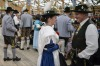 A man and woman in traditional bavarian clothing celebrate at the traditional tent after the Parade of Costumes and ...