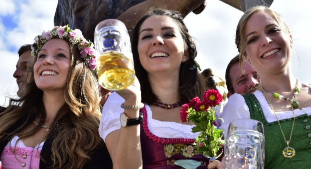 Young women celebrate the opening of the 182nd Oktoberfest beer festival in Munich, southern Germany.