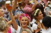 A young woman celebrates the opening of the 182nd Oktoberfest beer festival in Munich, southern Germany. The world's ...