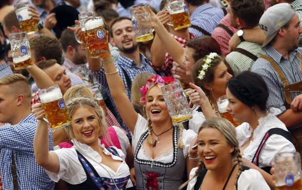 People celebrate the opening of the 182nd Oktoberfest beer festival in Munich, southern Germany.