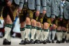 Participants dressed in Bavarian folk outfits march in the Parade of Costumes and Riflemen (Trachten- und Schuetzenzug) ...