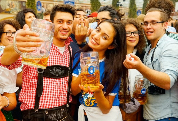Revelers drink beer at Hofbraeuhaus beer tent on the opening day of the 2015 Oktoberfest in Munich, Germany. The 182nd ...