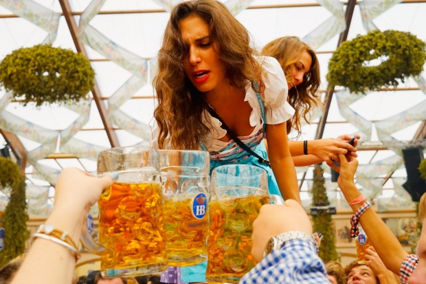 A young woman drinks beer at Hofbraeuhaus beer tent on the opening day of the 2015 Oktoberfest on September 19, 2015 in ...