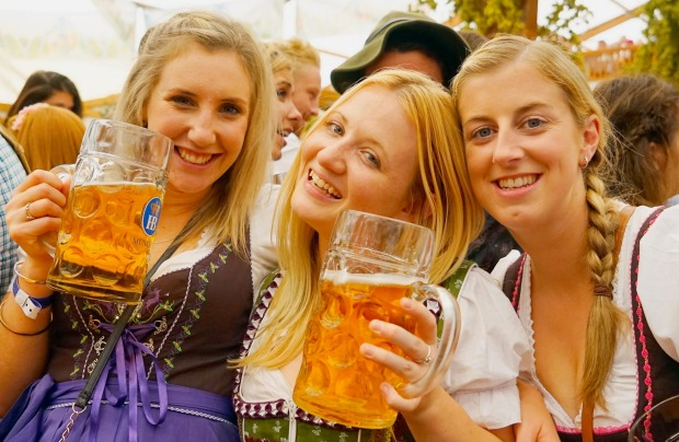 Revelers enjoy drinking beer at Hofbraeuhaus beer tent on the opening day of the 2015 Oktoberfest on September 19, 2015 ...